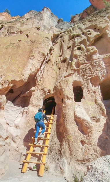 Exploring a cavate, or carved room, at Bandelier National Monument